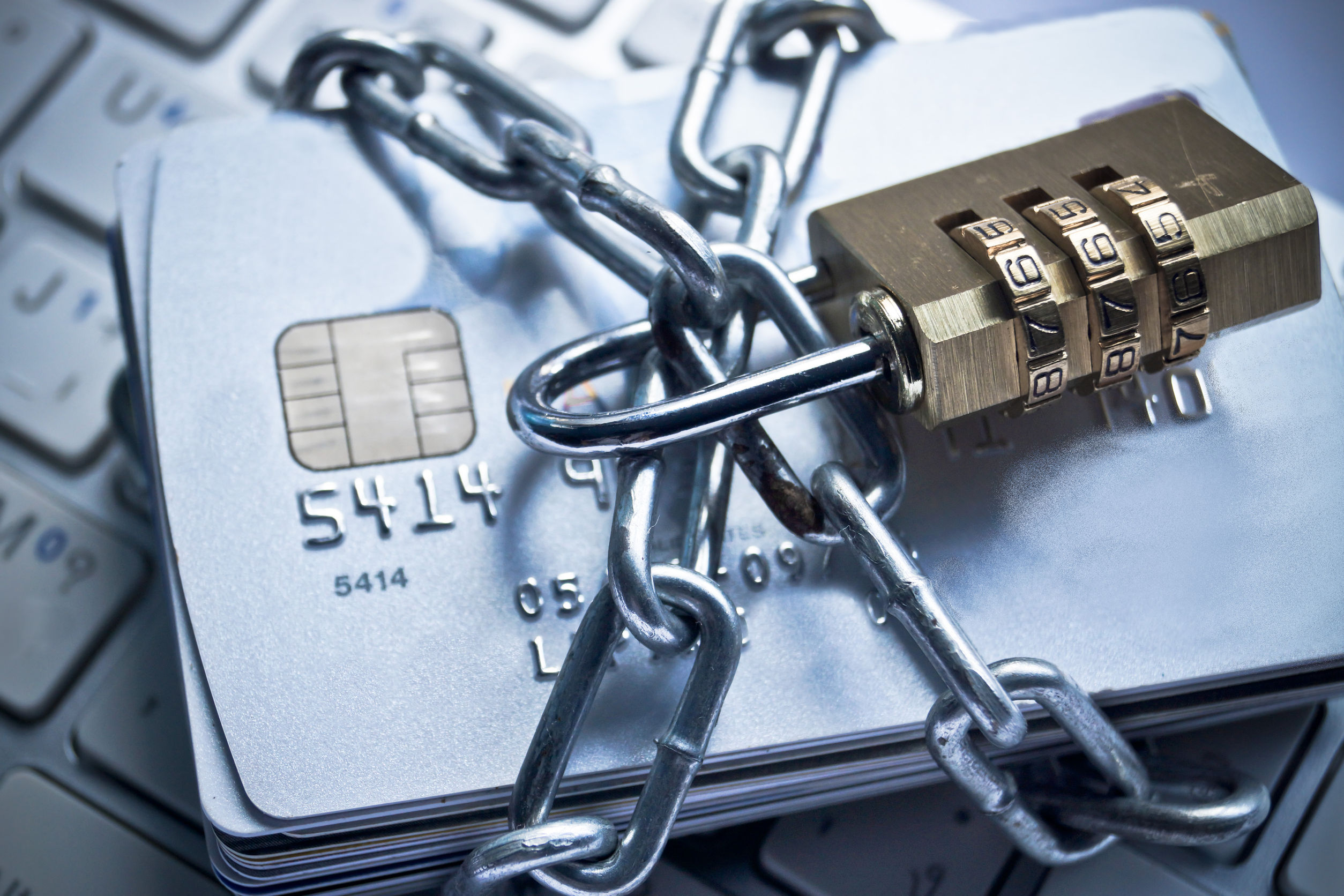 33146642 - chained credit cards security lock with password - phishing protection concept